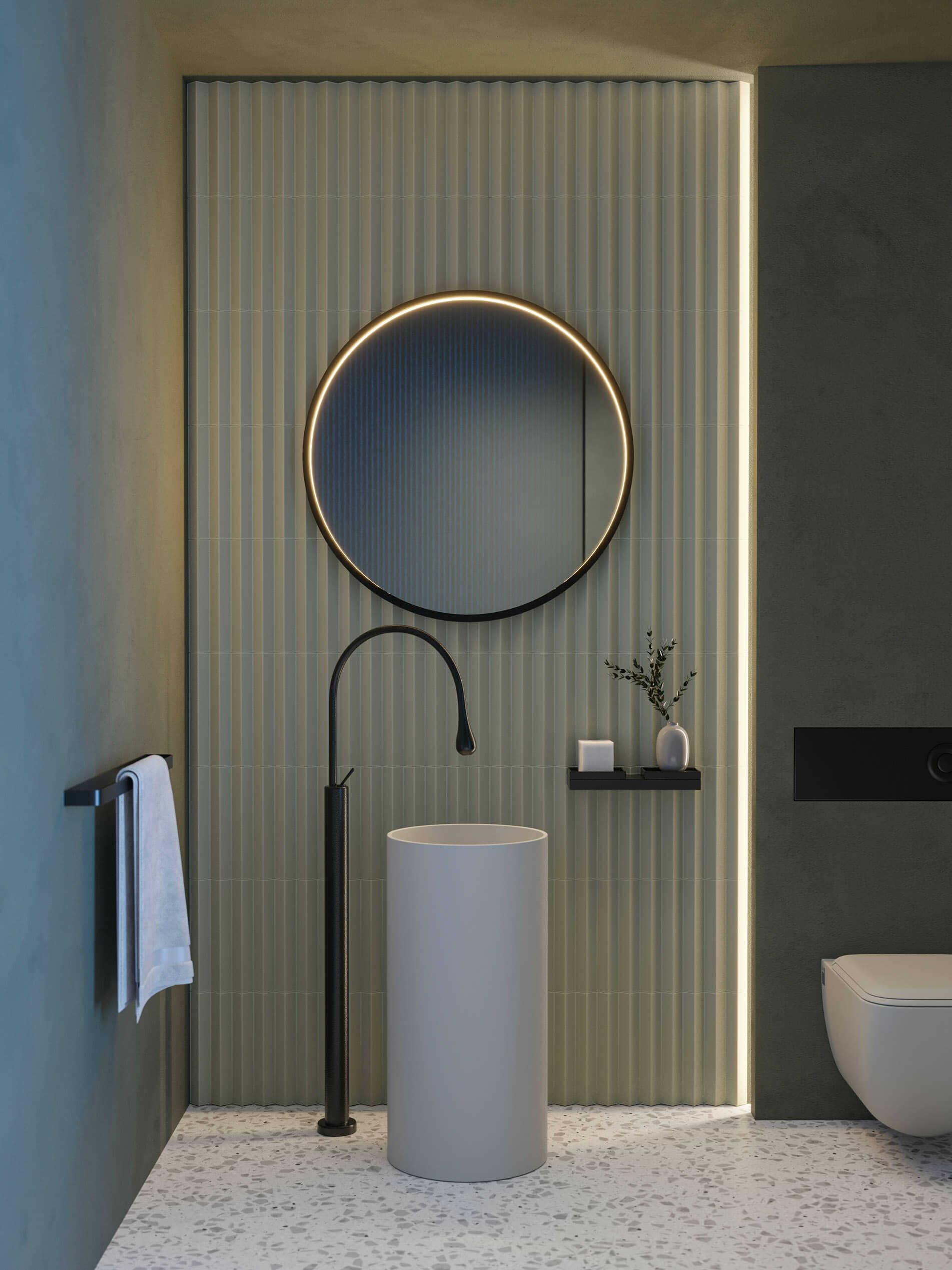 Rund Futon Mirror fra Intra Lighting på badet