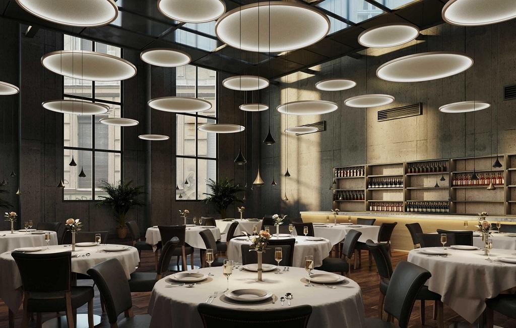 Mange Futon-armaturer fra Intra Lighting i restaurantmiljø